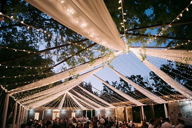 Unique tented wedding reception with string lights and clear tent- O'Malley Photography