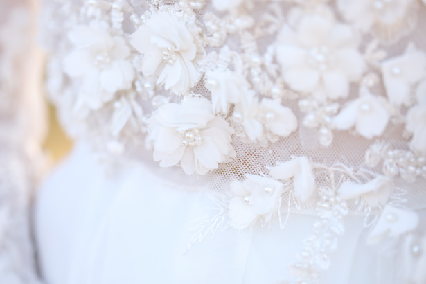 Unique wedding dress with delicate florals and beading - Photo: Tiffany Hudson Films