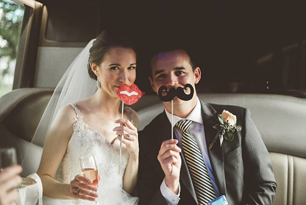 bride and groom fun photo in photobooth with props - Aileen Elizabeth Photography