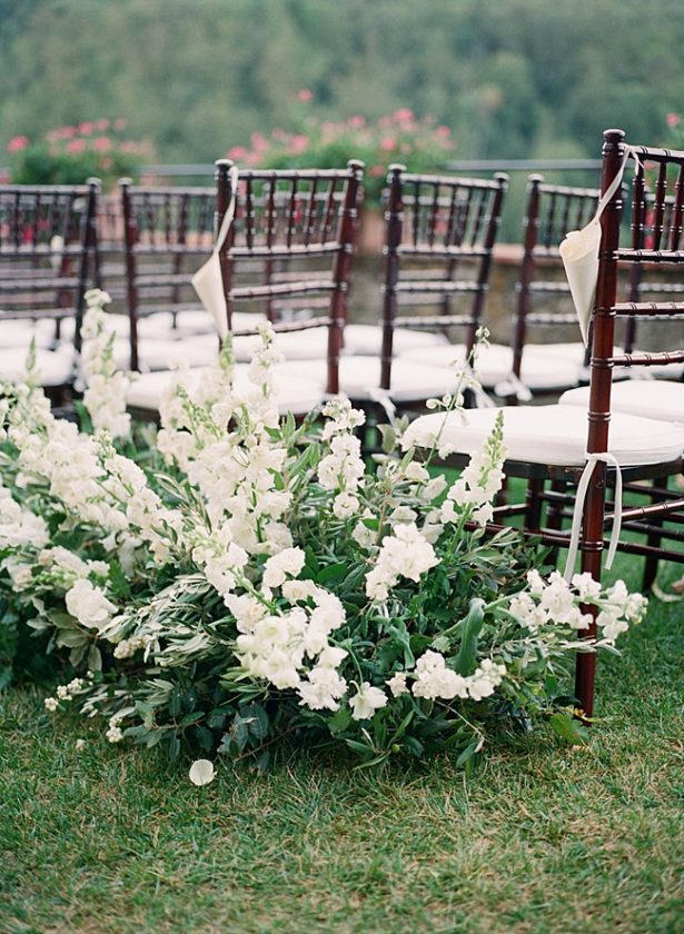All white and greenery wedding ceremony flowers for the aisle- Purewhite Photography