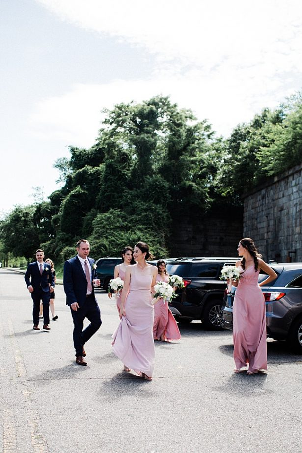 Bridal party walking to wedding ceremony - Bluespark Photography
