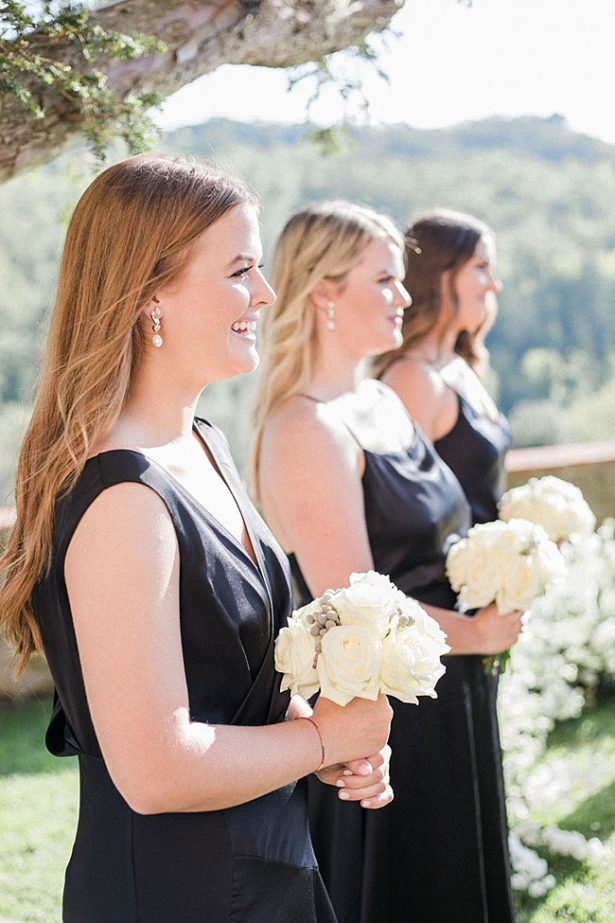 Bridesmaids in black dresses with white bouquets and hair down - Purewhite Photography