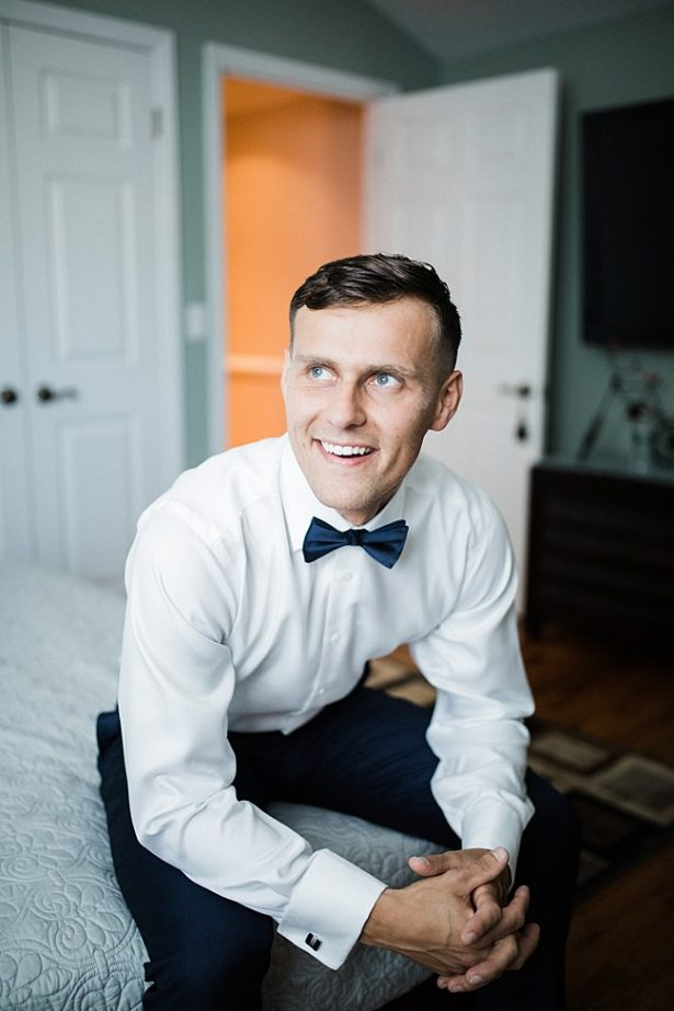 Classic getting ready photo of groom on his wedding day in a bowtie - Bluespark Photography