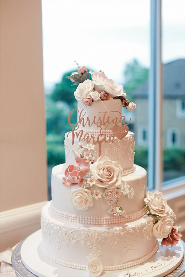 Country Club Wedding cake with tons of flowers and a unique cake topper - Photography: NST Pictures
