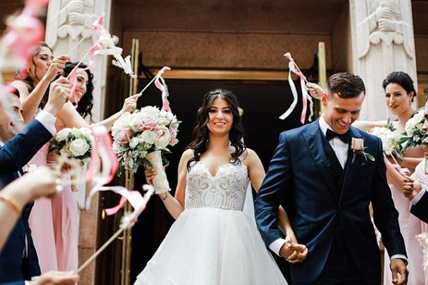Country Club Wedding exit from ceremony to ribbon wands - Bluespark Photography