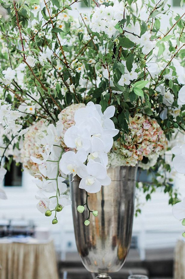 Country Club Wedding reception centerpiece with white orchids and greenery - Bluespark Photography