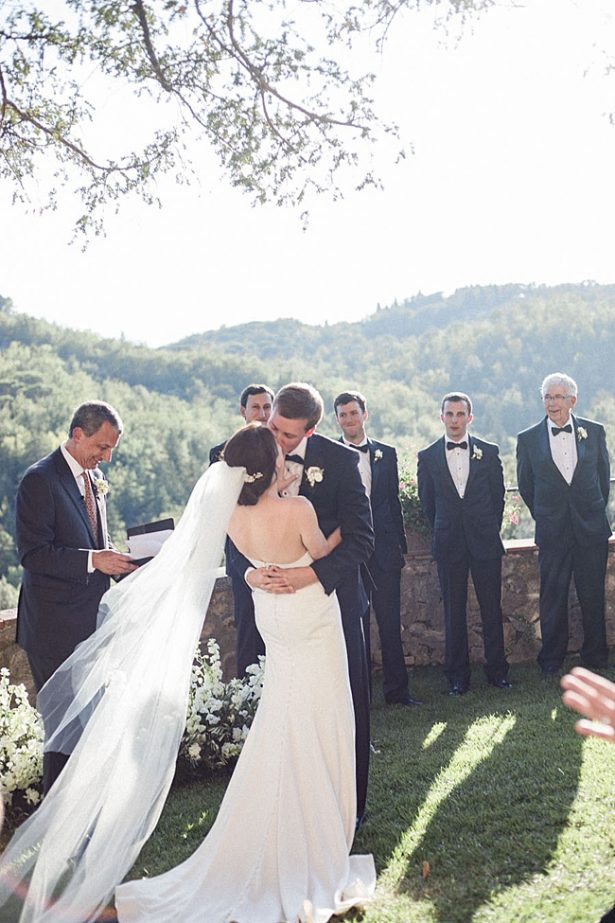 First kiss as husband and wife during wedding ceremony - Purewhite Photography