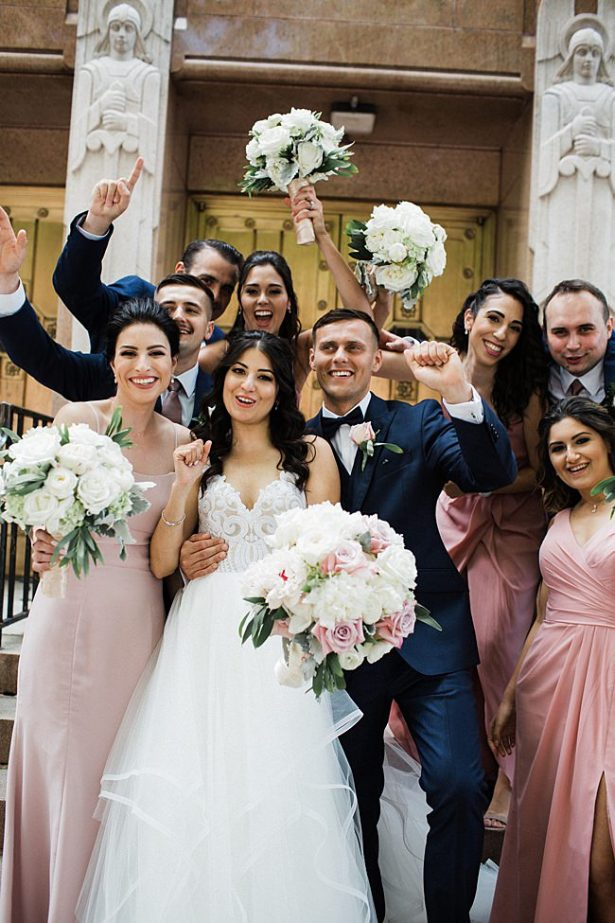 Fun photo of bride and groom celebrating with their bridal party - Photography: NST Pictures