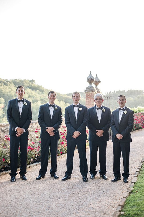 Groom and groomsmen in black tuxes and bowties - Purewhite Photography