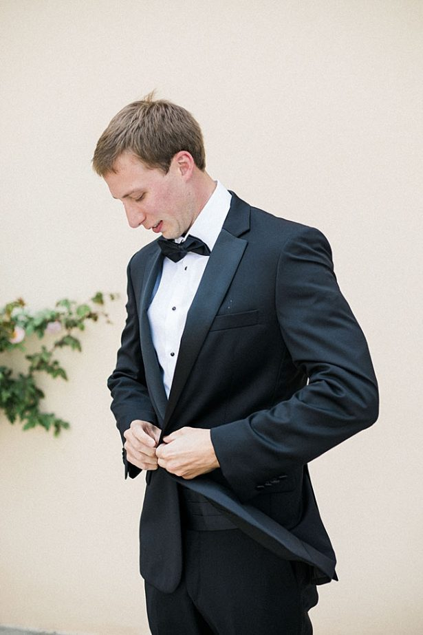 Groom getting ready in black tux with bowtie - Purewhite Photography