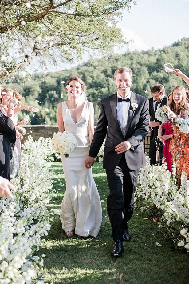 Photo of bride and groom recessional with petal toss - Purewhite Photography