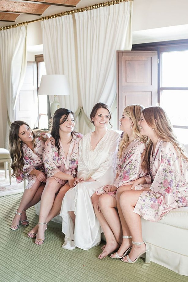 Photo of bride with bridesmaids in matching robes - Purewhite Photography