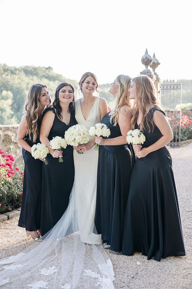 Photo of bride and bridesmaids with black bridesmaids dresses- Purewhite Photography