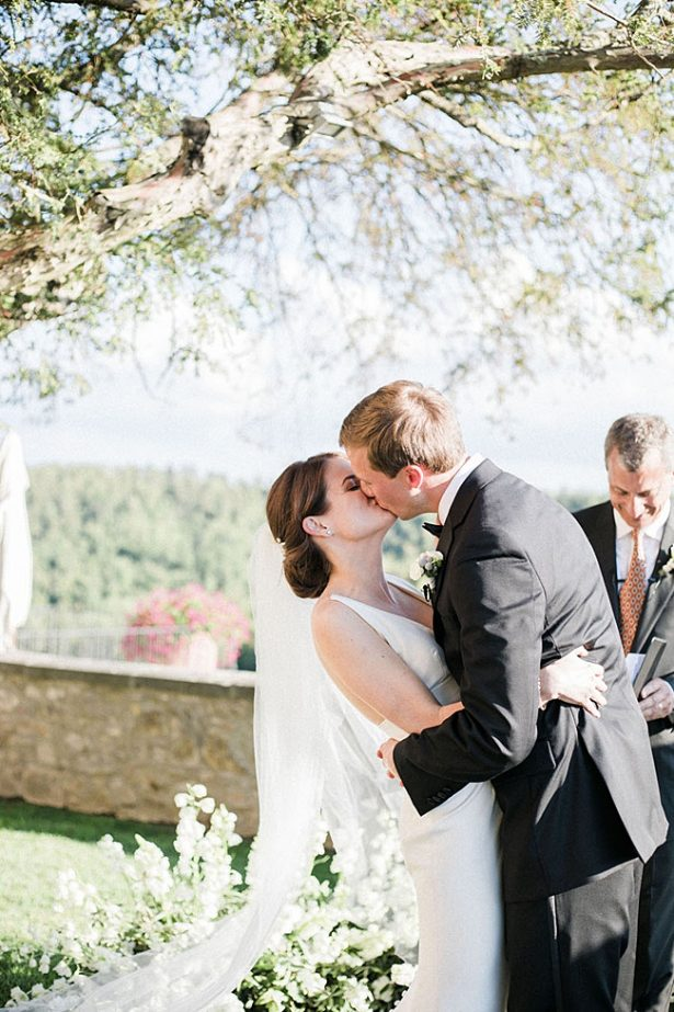 Romantic photo of bride and grooms first kiss - Purewhite Photography