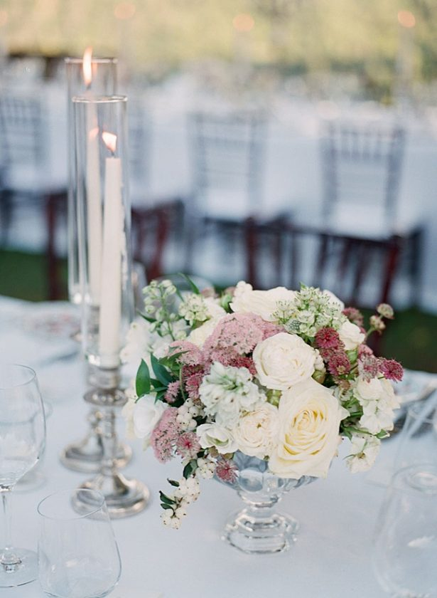 Romantic white and mauve wedding reception centerpiece with tall glass votives - Purewhite Photography