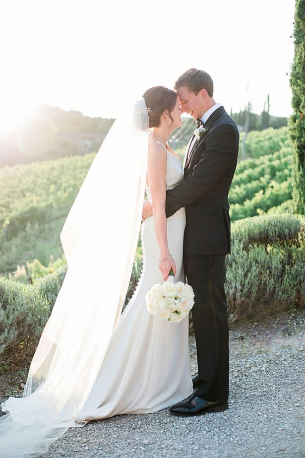 Sunset wedding photo of bride and groom in Tuscany vineyard- Purewhite Photography