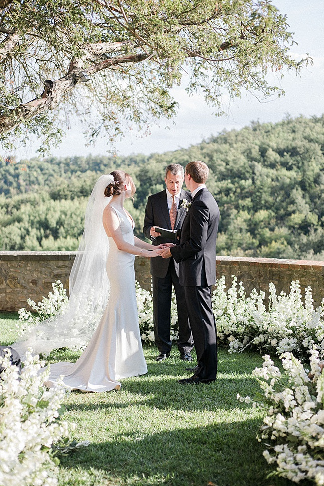 Tuscany Wedding ceremony photo of bride and groom holding hands - Purewhite Photography