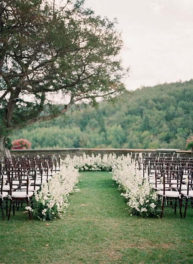 Tuscany Wedding outdoor wedding ceremony with a flower lined aisle- Purewhite Photography