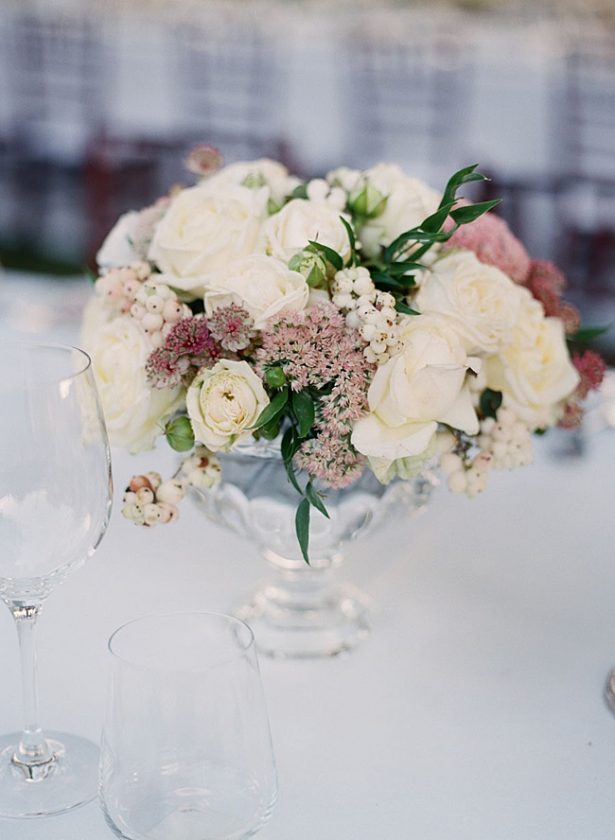 Tuscany Wedding reception centerpiece with white and mauve flowers - Purewhite Photography