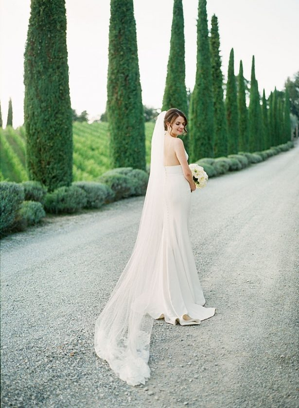 Tuscany Wedding romantic bridal portrait by cypress trees with cathedral veil- Purewhite Photography