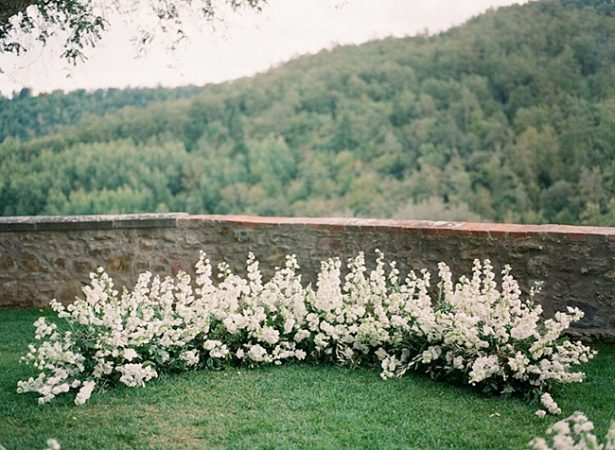Unique wedding ceremony flower decor overlooking the mountains of Tuscany - Purewhite Photography