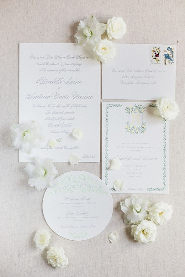 White wedding inviation suite with custom crest and flowers- Purewhite Photography