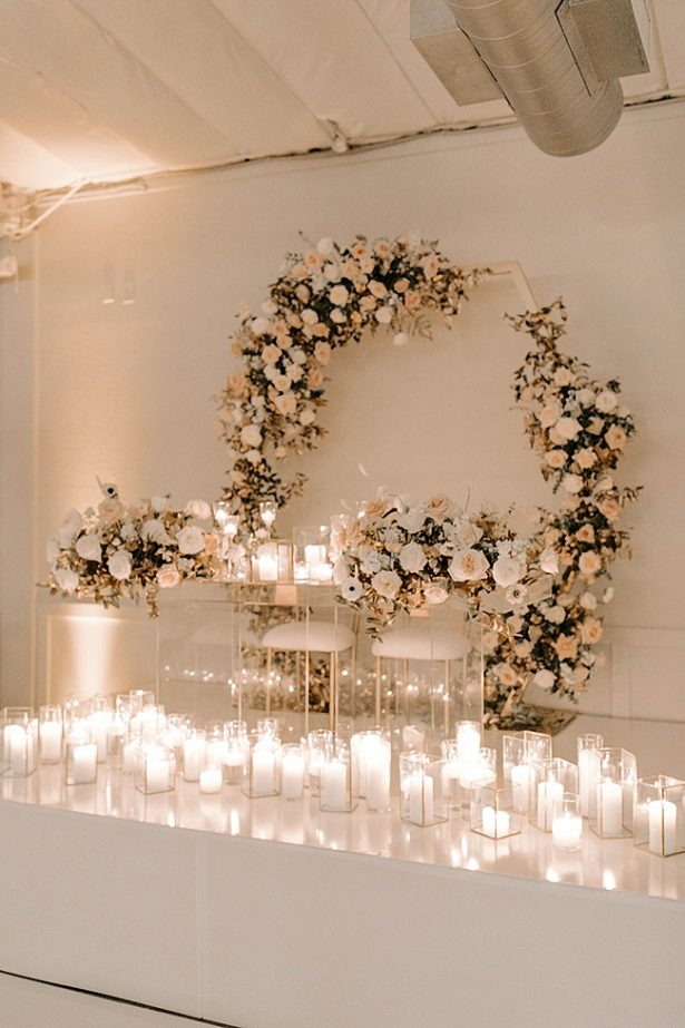 Candlelit acrylic sweetheart table with floral arch- Foolishly Rushing In Photography
