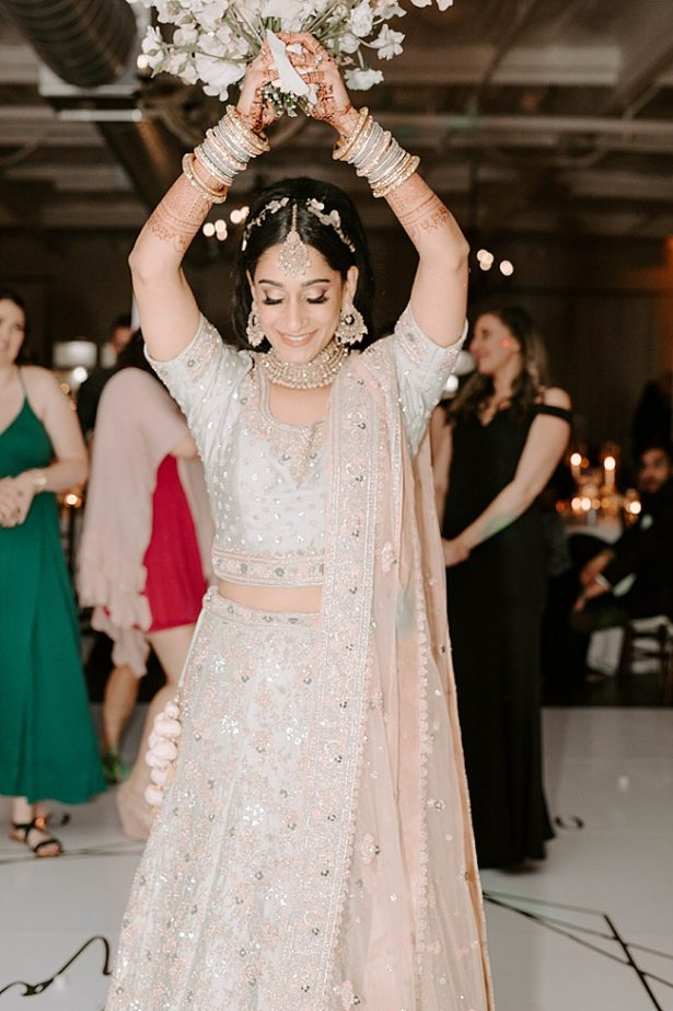 Indian bride tossing the bouquet- Foolishly Rushing In Photography