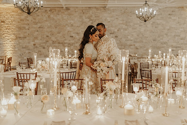 South Asian Bride and groom at romantic candlelit wedding reception- Foolishly Rushing In Photography