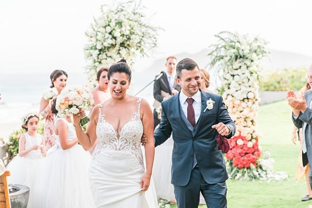 Bride and groom walking down the aisle - Photography: JBJ Pictures