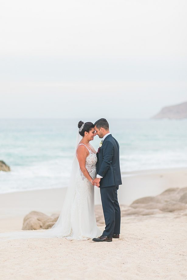 Cabo Destination Wedding photo of bride and groom on the beach - Photography: JBJ Pictures