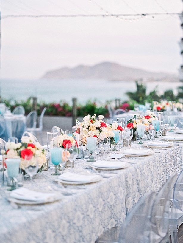 Cabo Destination Wedding reception overlooking the ocean main table setup - Photography: JBJ Pictures