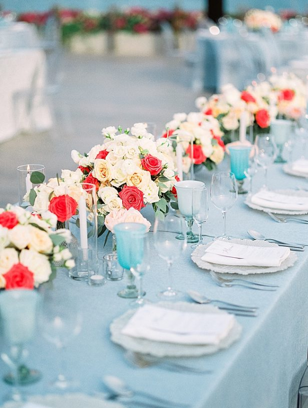 Cabo Destination Wedding reception table set up with peach and blue decor - Photography: JBJ Pictures
