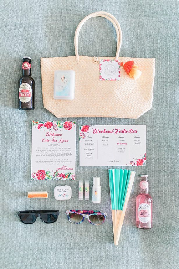 Cabo Destination Wedding welcome bag with fan sunglasses and drinks - Photography: JBJ Pictures