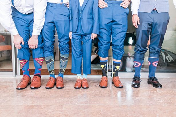 Fun photo of groom with groomsmen showing off goofy socks - Photography: JBJ Pictures