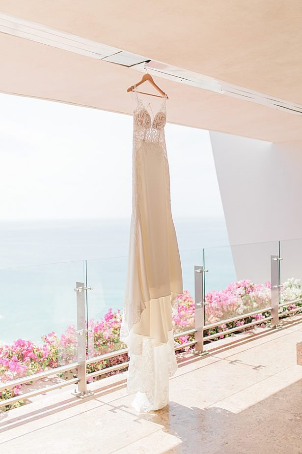 Hanging wedding dress near the water for Cabo Destination Wedding - Photography: JBJ Pictures