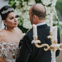 Sweet photo of bride and groom during ceremony - Photo: Dmitry Shumanev Production