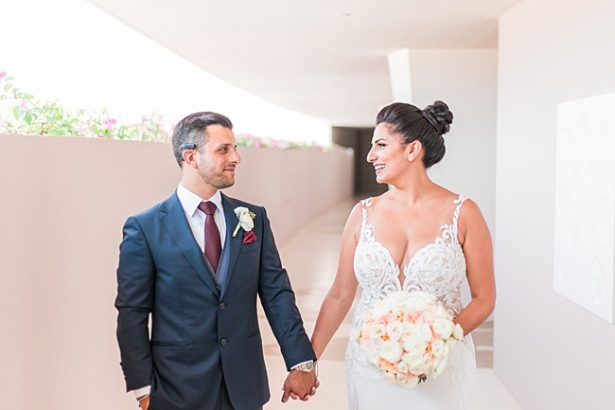 Sweet photo of bride and groom holding hands - Photography: JBJ Pictures
