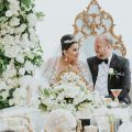 White and Gold Opulent Wedding sweetheart table with bride and groom - Photo: Dmitry Shumanev Production