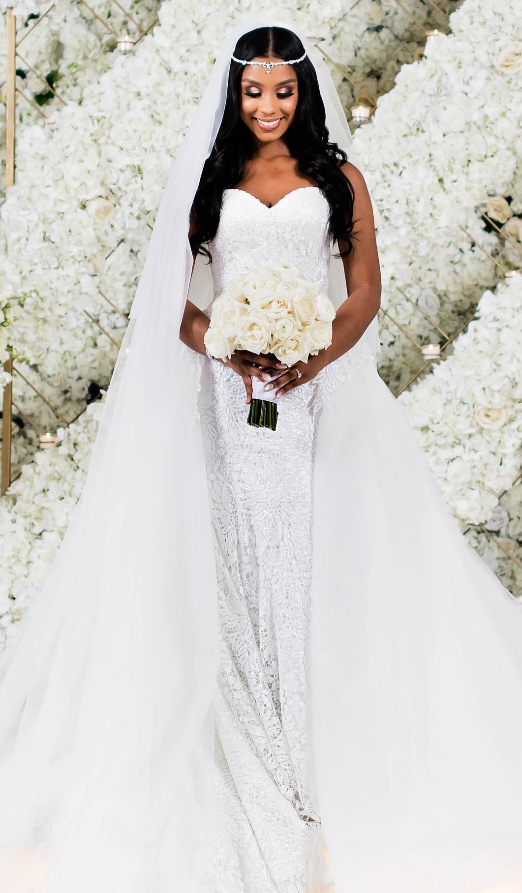African American bride with a lace strapless wedding dress with overskirt - Photography: Pharris Photos