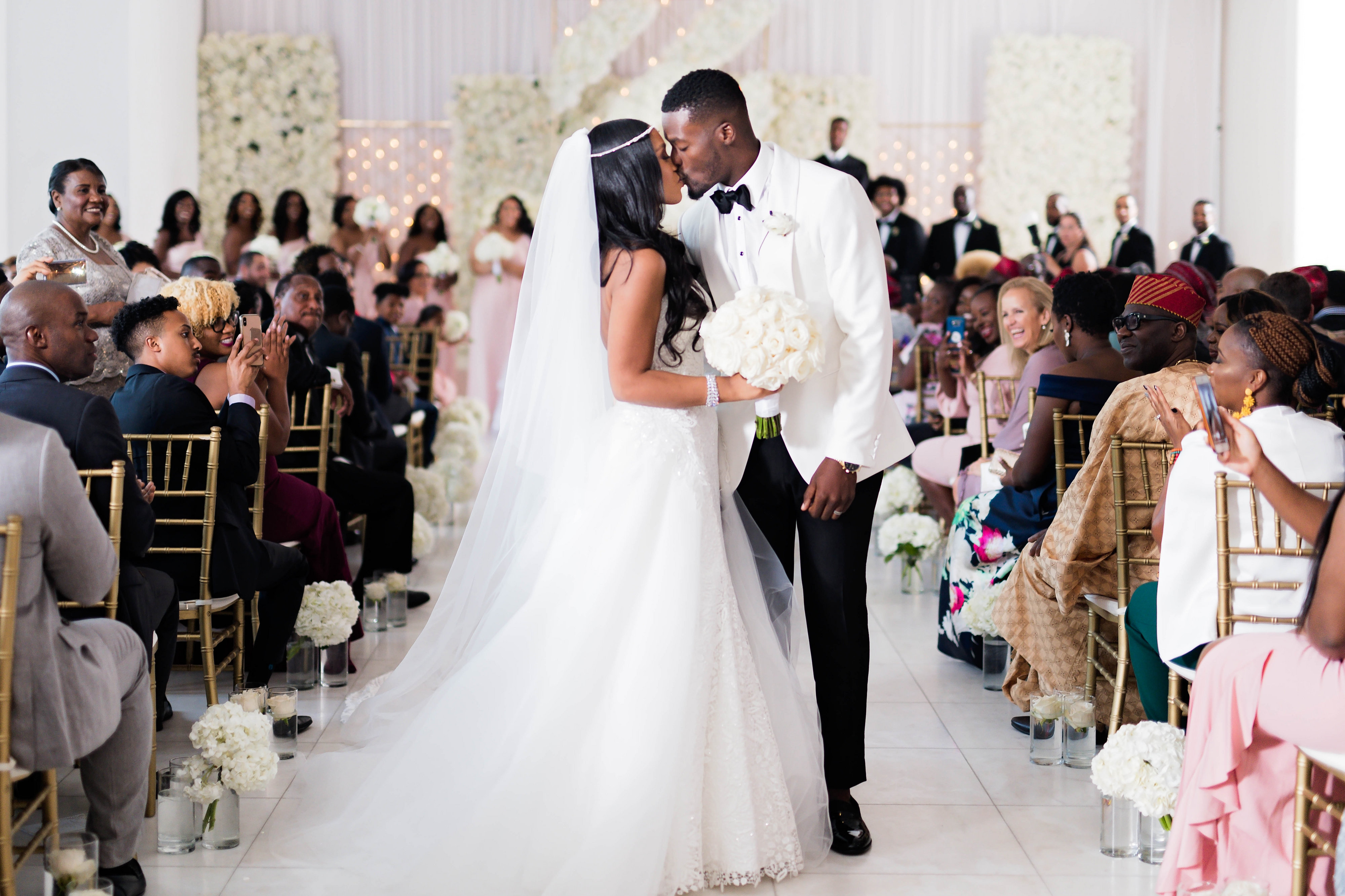Luxury black bride and African American groom photo at their ceremony - Photography: Pharris Photos
