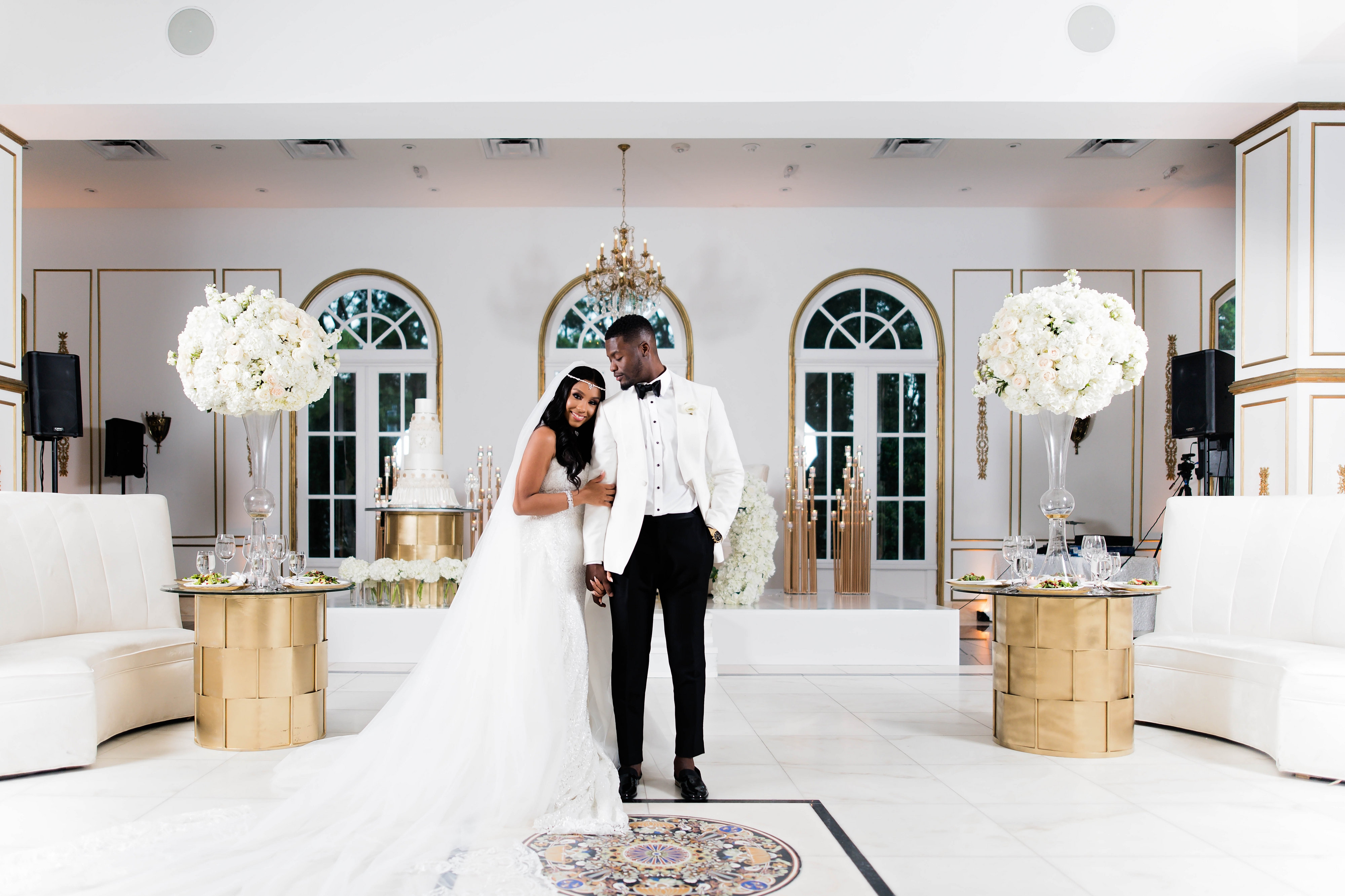 Luxury bride and groom photo at their white and gold wedding reception - Photography: Pharris Photos