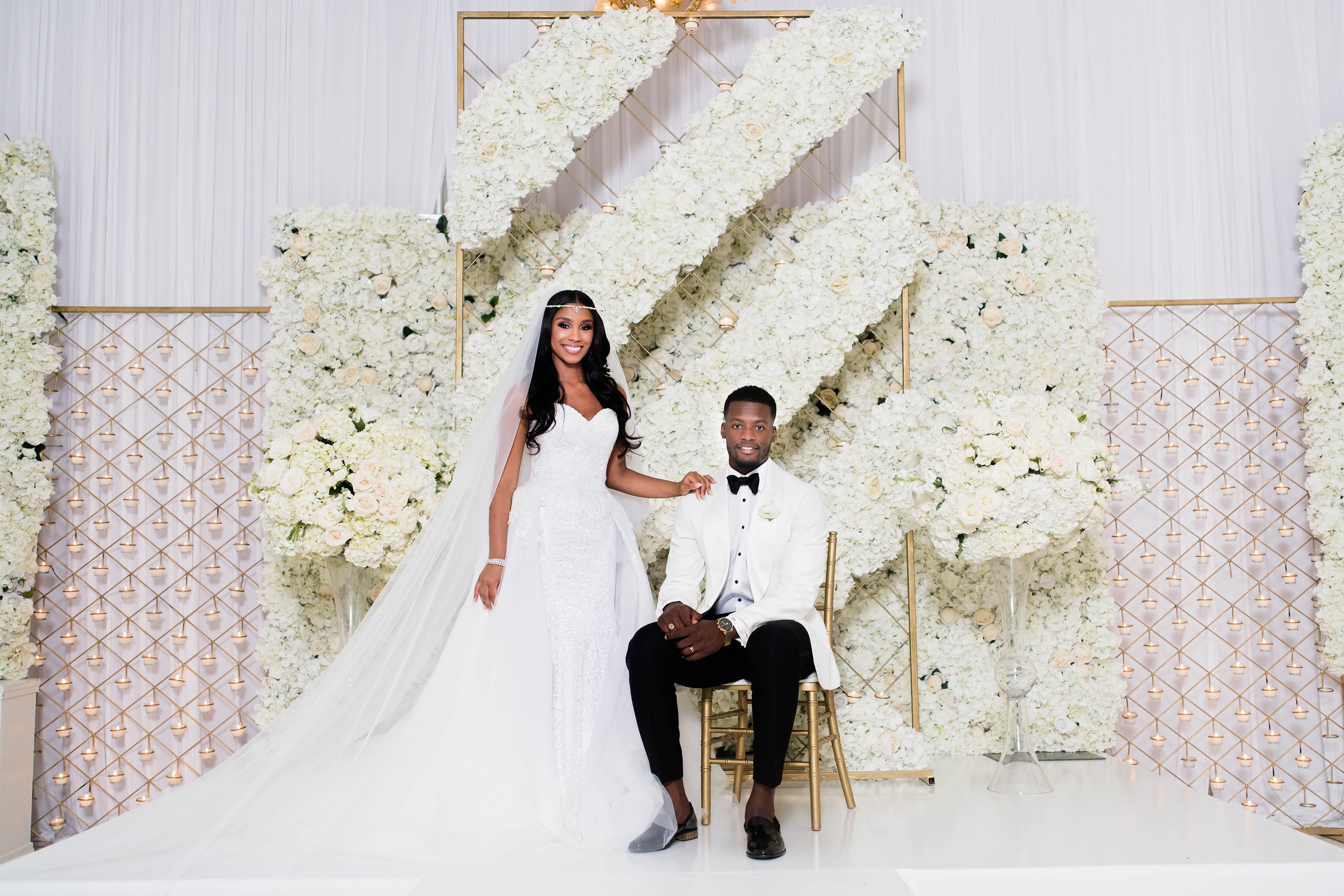 Luxury wedding with floral background and an African American couple - Photography: Pharris Photos