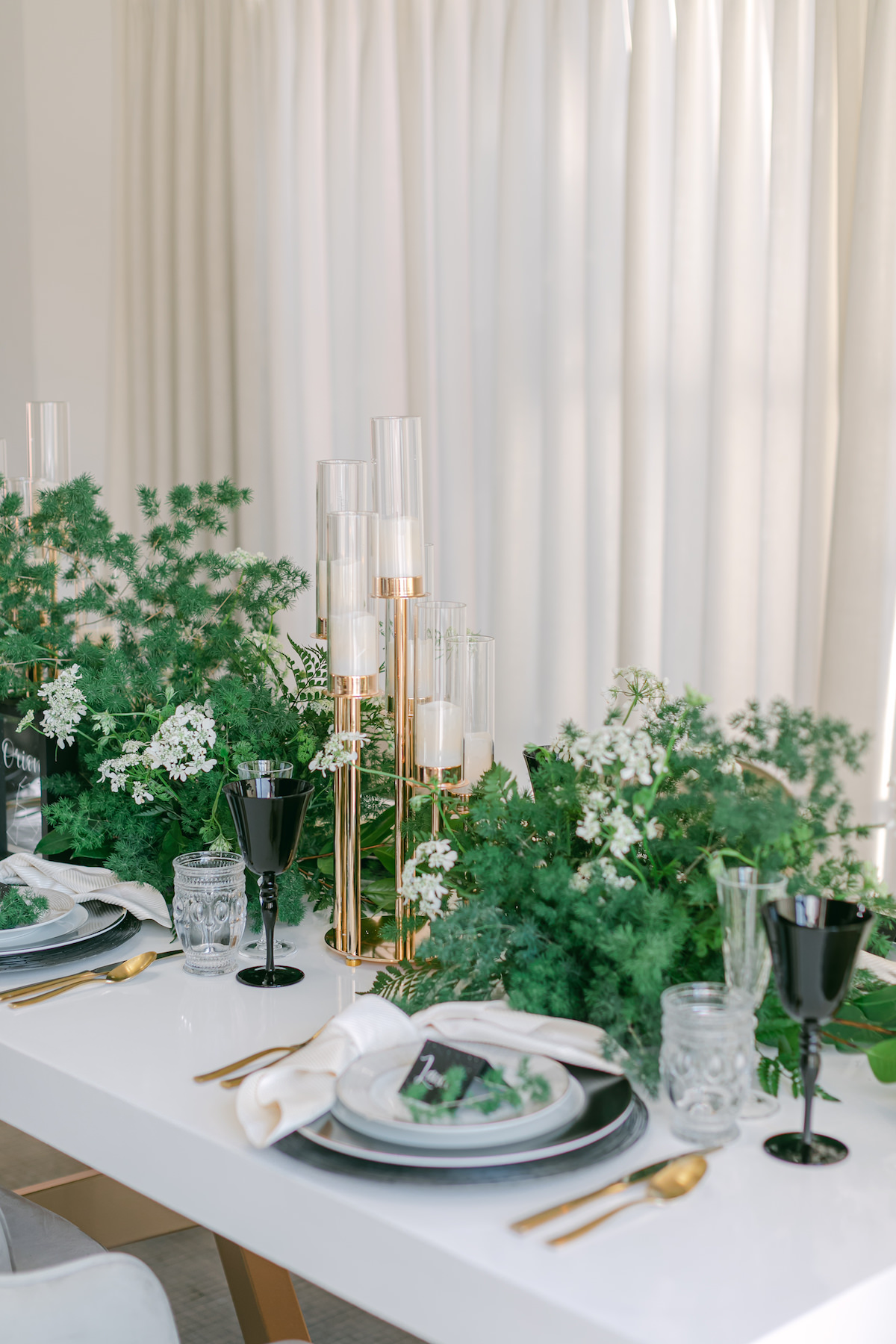 Minimalist contemporary table with greenery centerpieces - Lily Tapia Photography