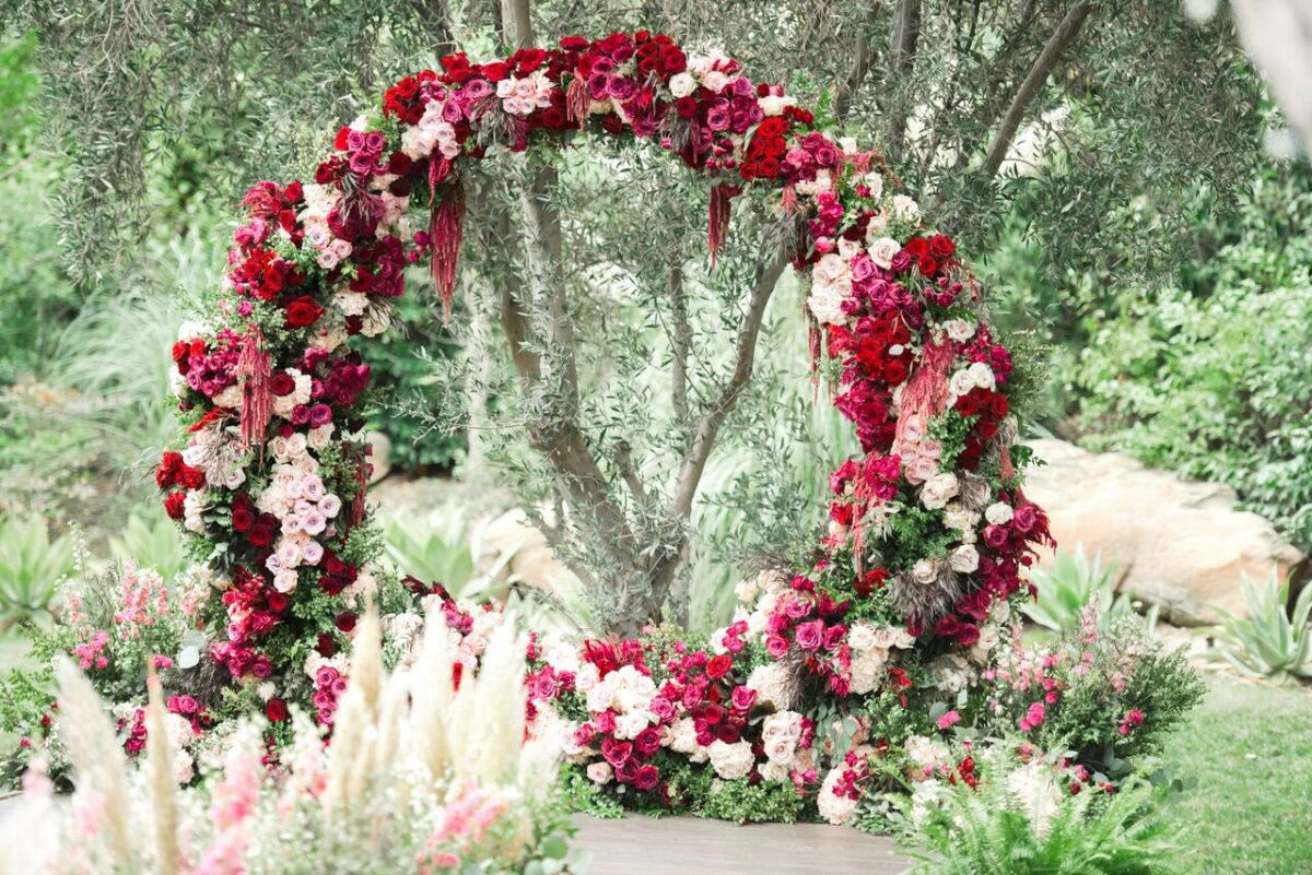 Red and pink Floral Wedding Ceremony arch - Photography: Dmitry Shumanev