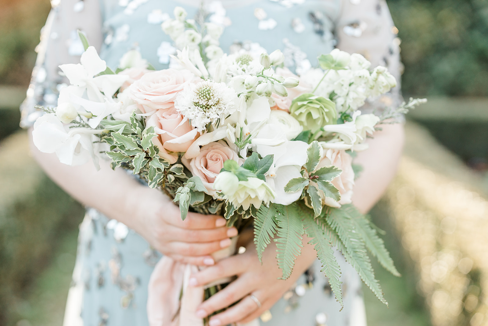 Wedding bouquet with blush roses Bride wearing a light blue wedding dress - Kelsie Scully Photography