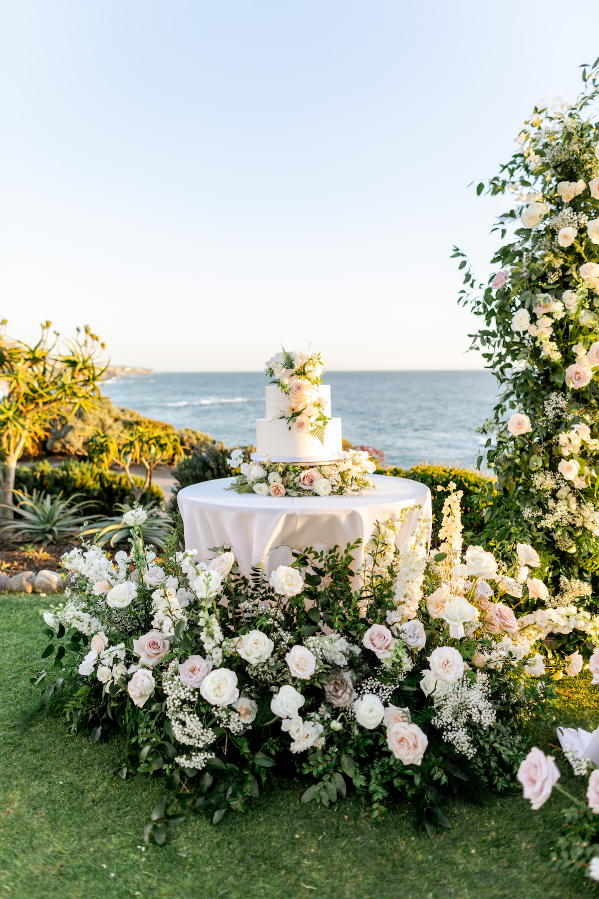 Luxury Wedding cake table decorated with flowers - Holly Sigafoos Photo