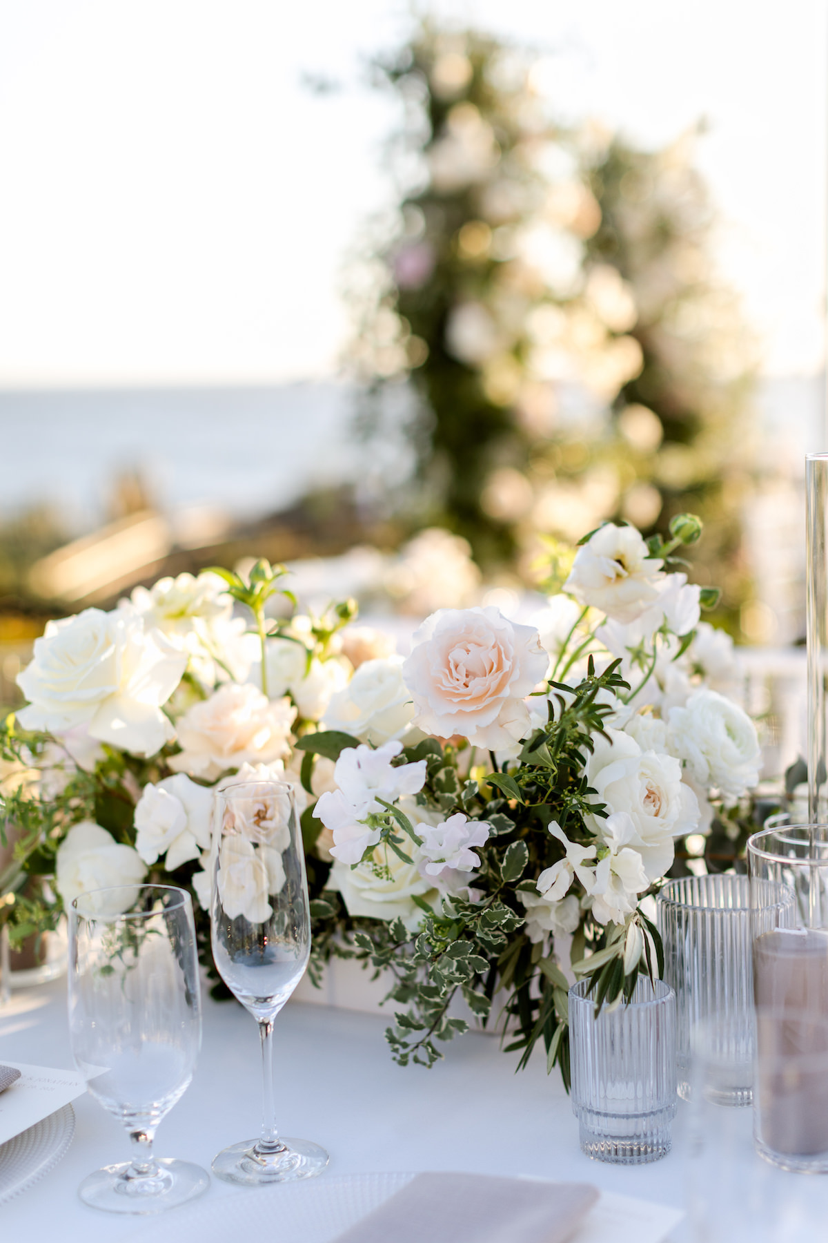 Romantic spring wedding centerpiece with neutral colors - Holly Sigafoos Photo
