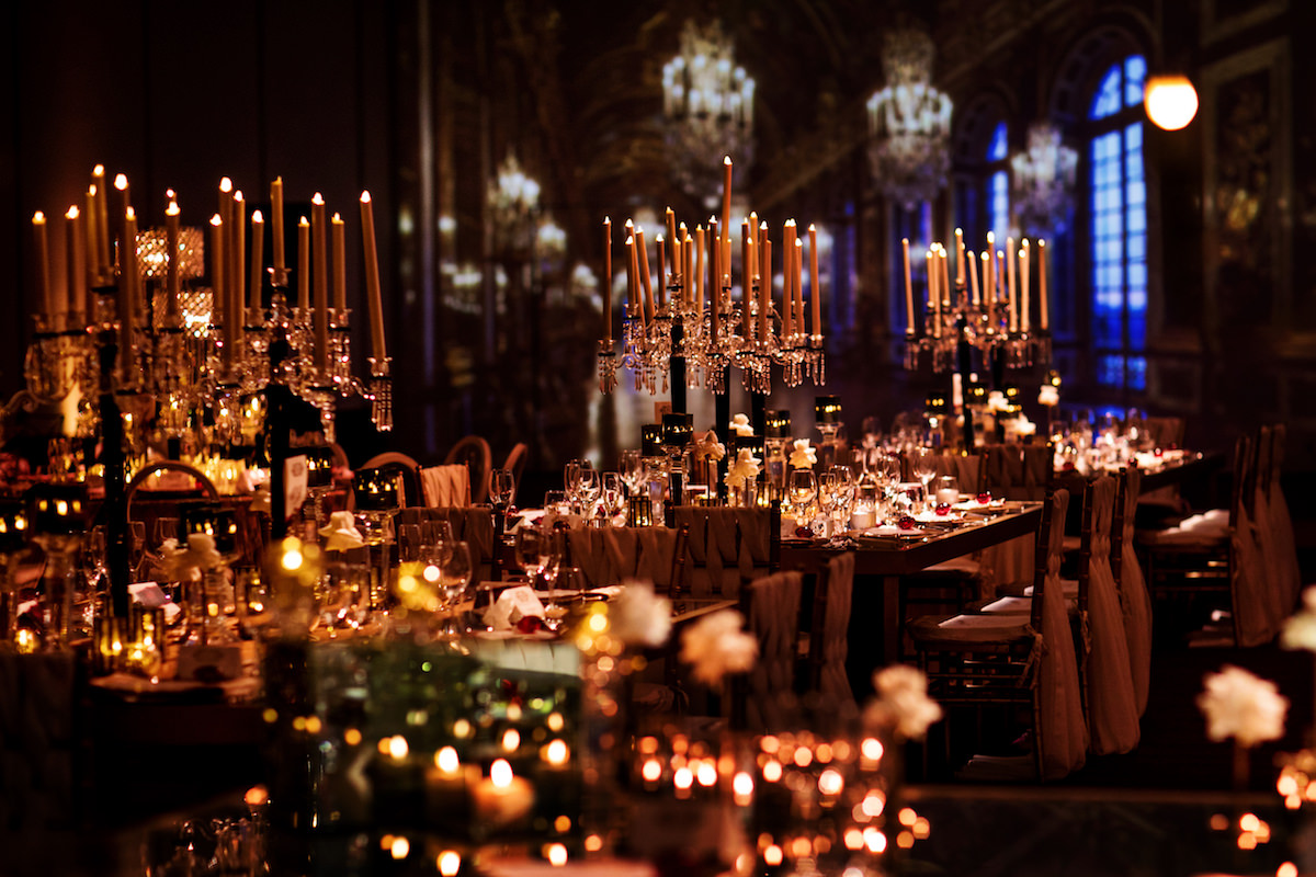 wedding reception with crystal chandeliers and candelabras - Nadia D Photo