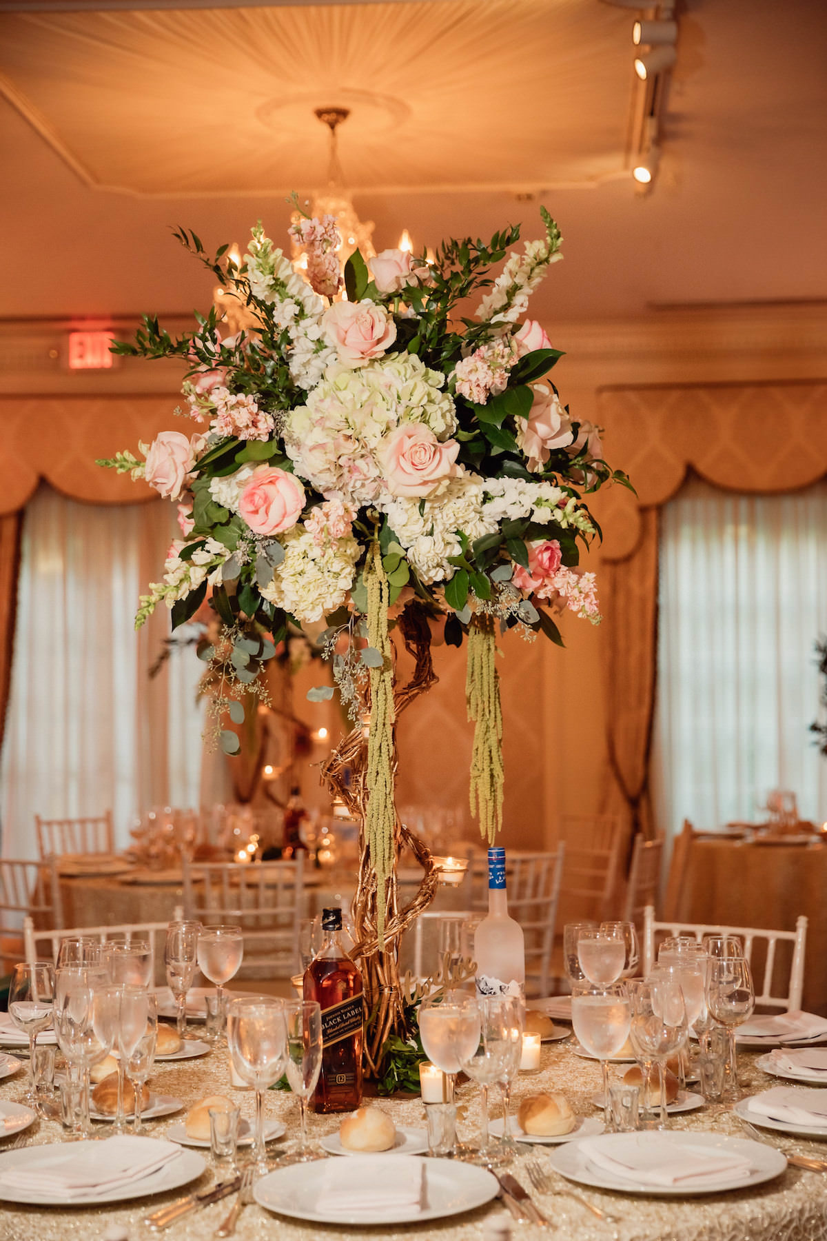 Glamorous tall wedding centerpiece - Photography: Charming Images